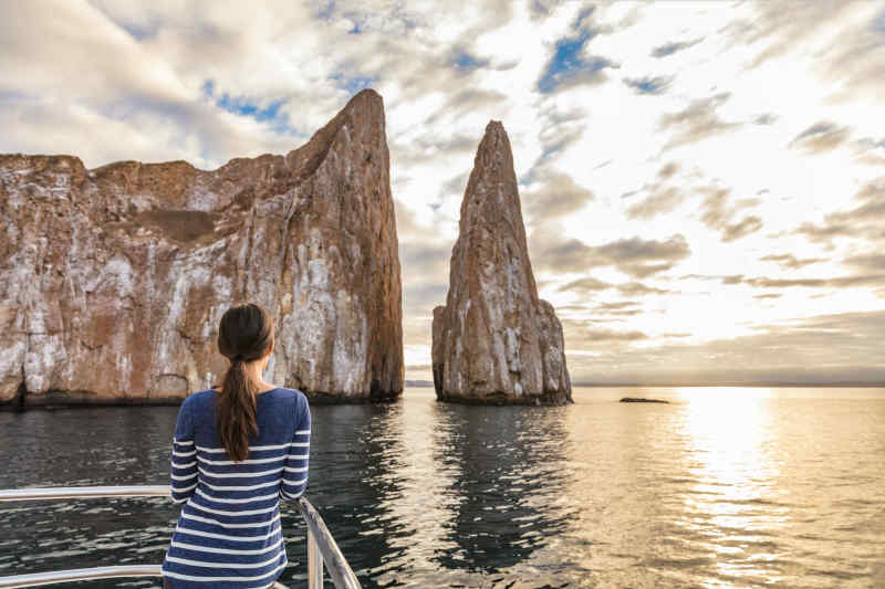 Tourist on boat cruise • Galapagos Islands, Ecuador