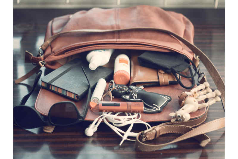 An outurned purse with various items spilled out.