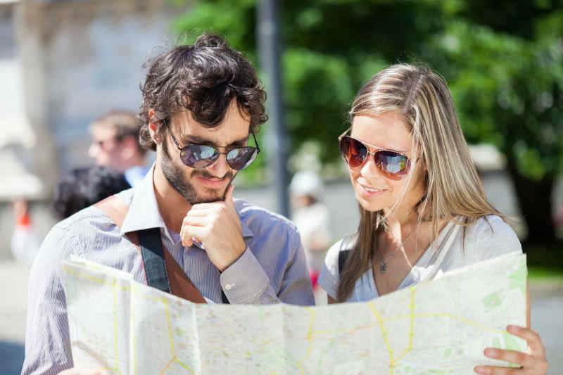 Tourists looking at map