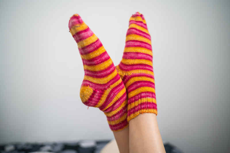 Brightly colored pink and yellow striped socks.
