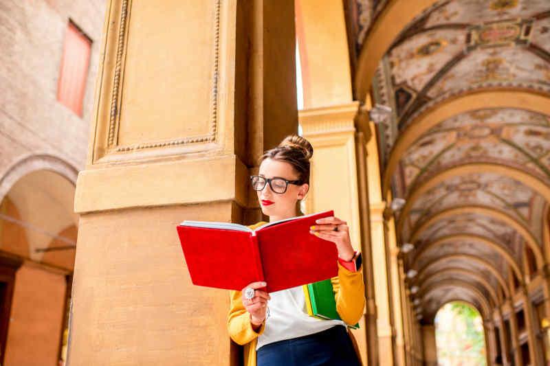 Italian woman reading in Bologna