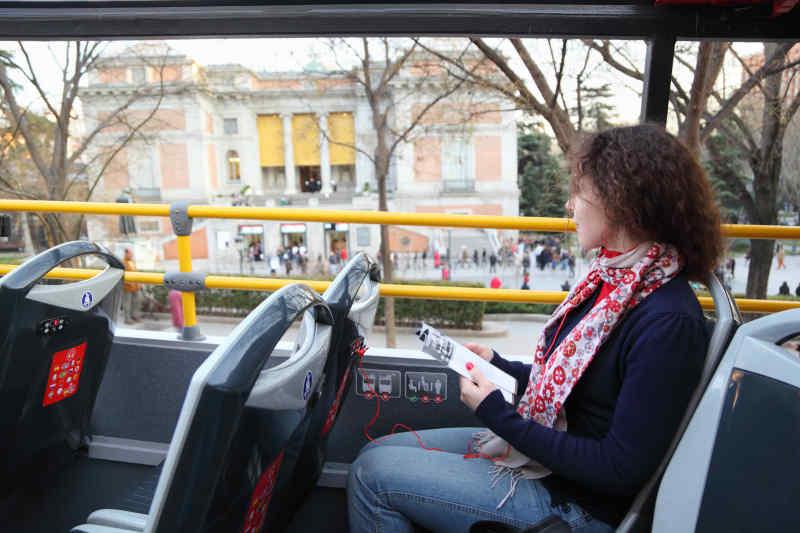 Tourist on open-top bus