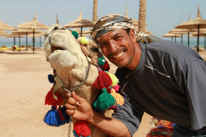 Friendly man with camel