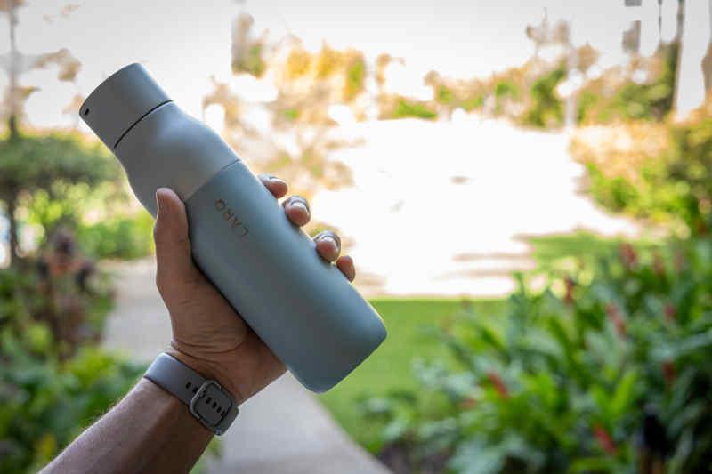 Water bottle in a hand.