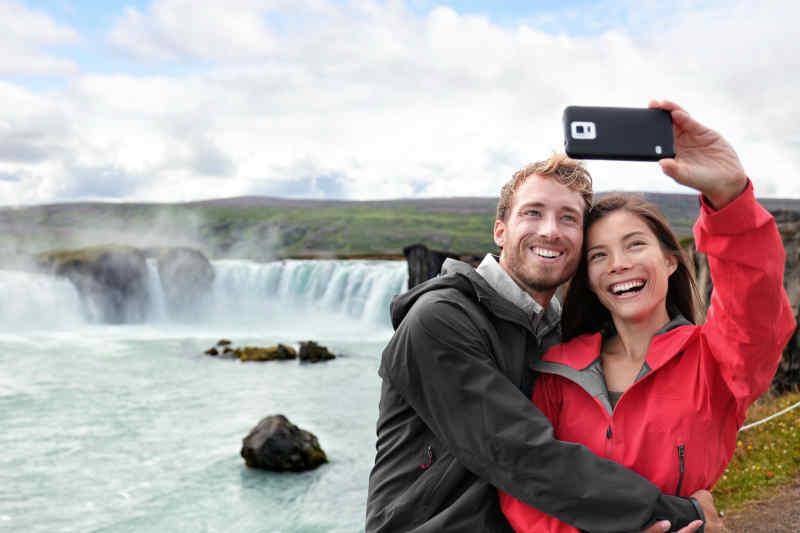 Couple at Godafoss Waterfall