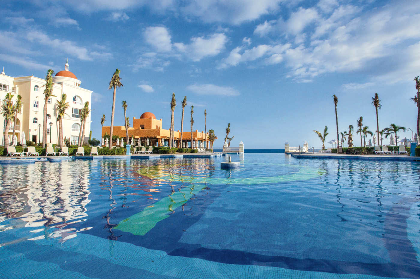 Wake up to the pacific ocean at the hotel riu palace cabo san lucas a 5 star resort hotel surrounded by splendid gardens with beautiful views of the beach