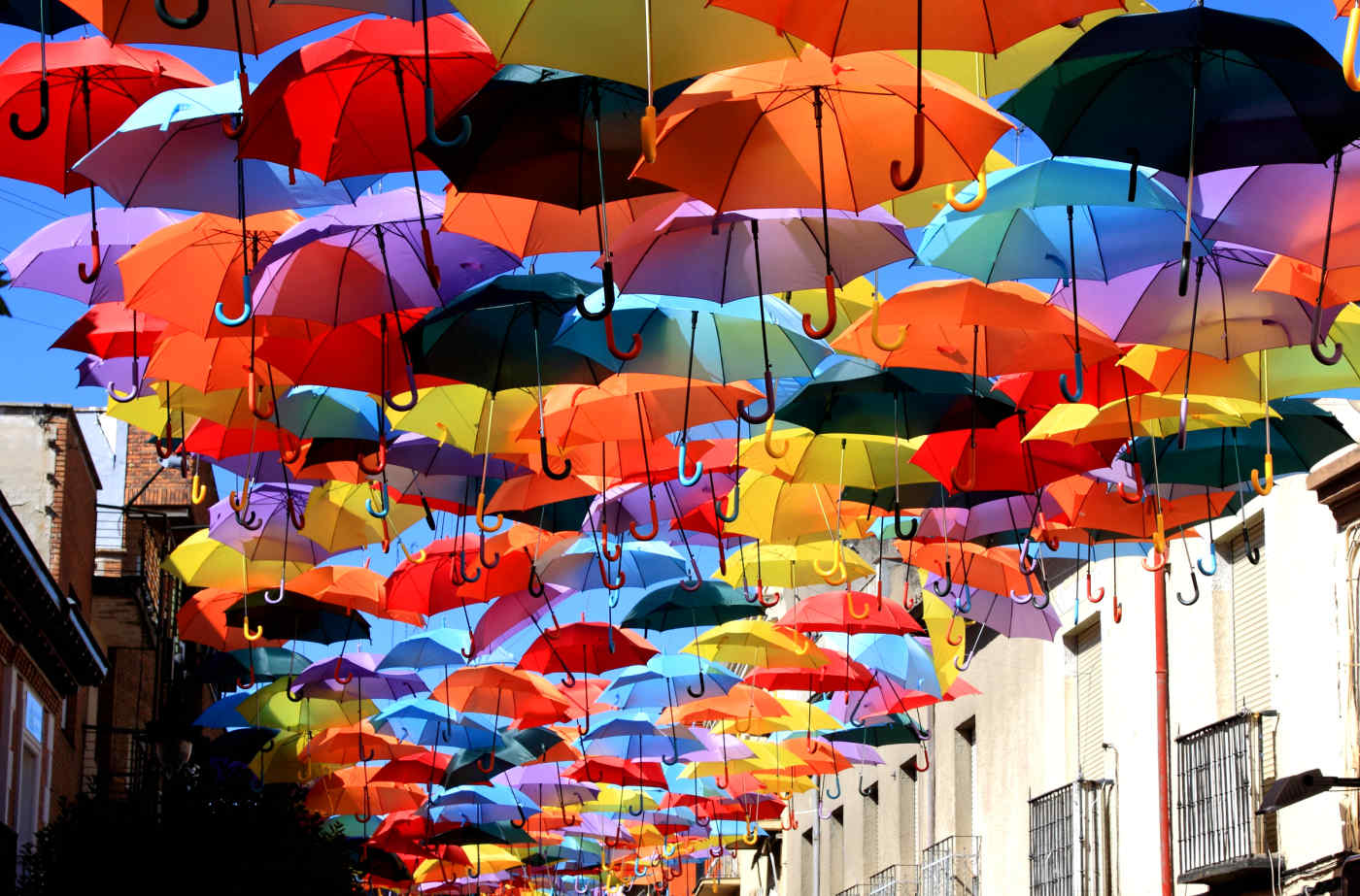 Street decorated with colored umbrellas in Madrid, Spain