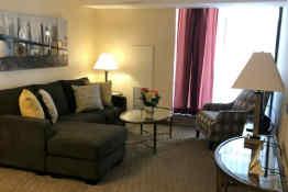 Cartier Place Suite Hotel - Living Room