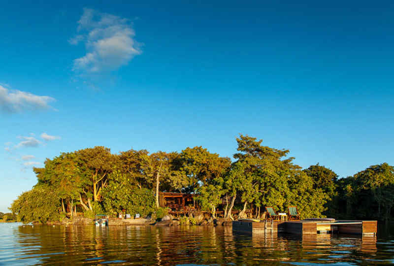 Jicaro Island Lodge • View of lodge from lake