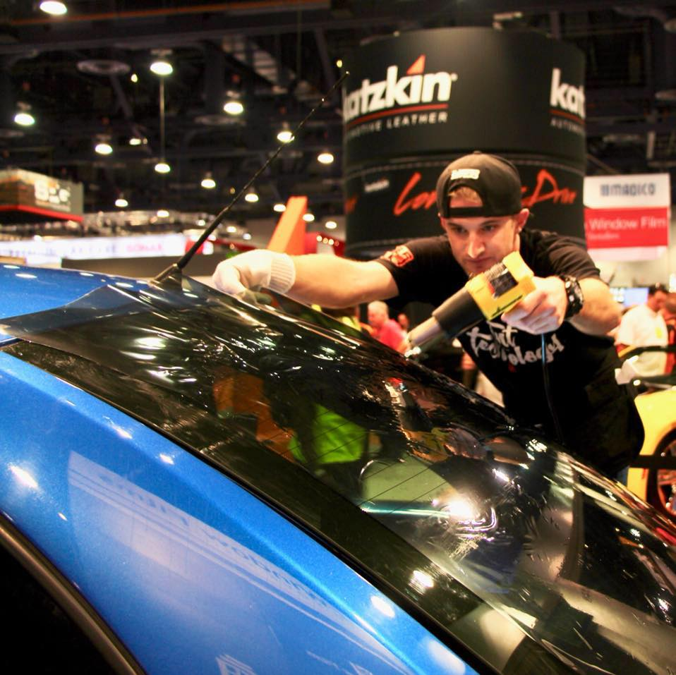 Shae Ege the owner and operator of Shade Setters tinting a car at SEMA