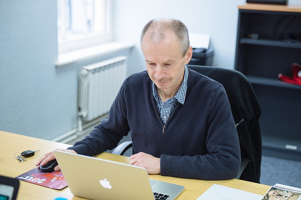 Clive Walker working at a desk