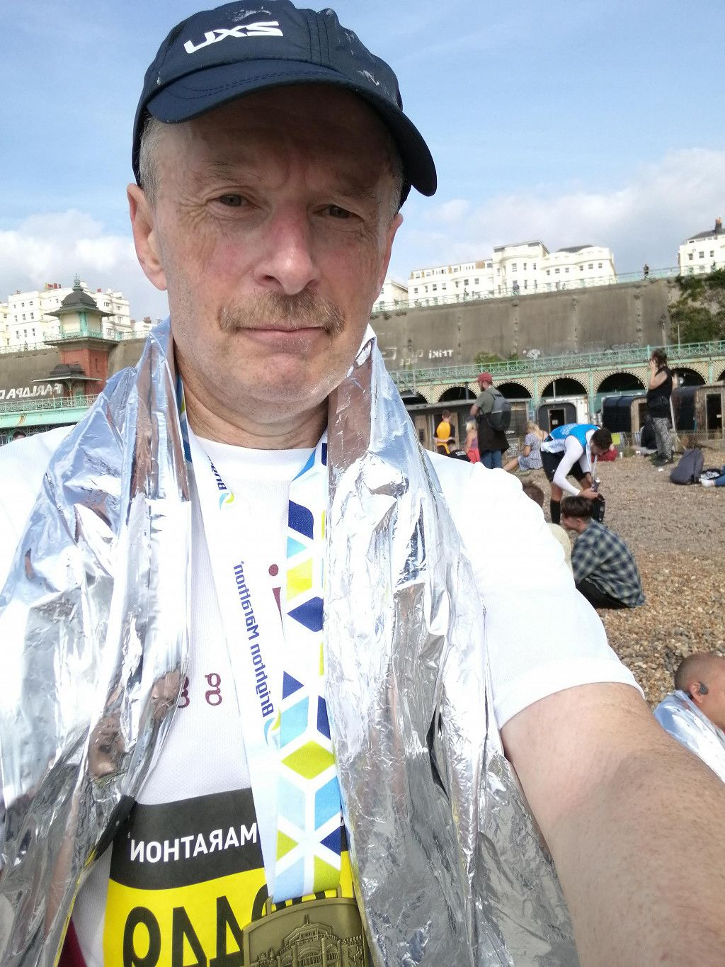 Me with medal after the finish. Looking a lot better than I felt at the time!