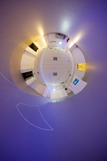 Reverse stereographic panorama of a purple room.