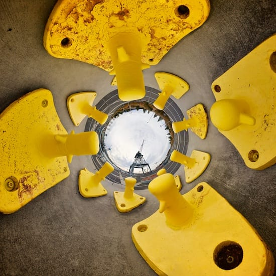 Reverse stereographic panorama of yellow harbour anchors.