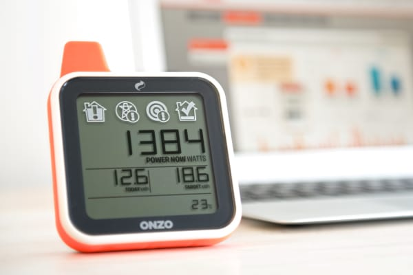 Photo of an energy display showing amount of power being used in a home.