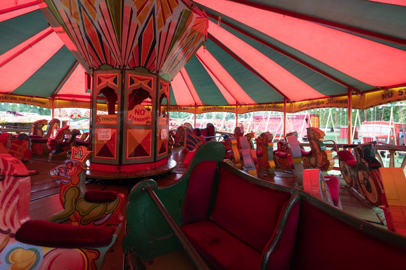 A view inside of a vintage wooden fair ride.
