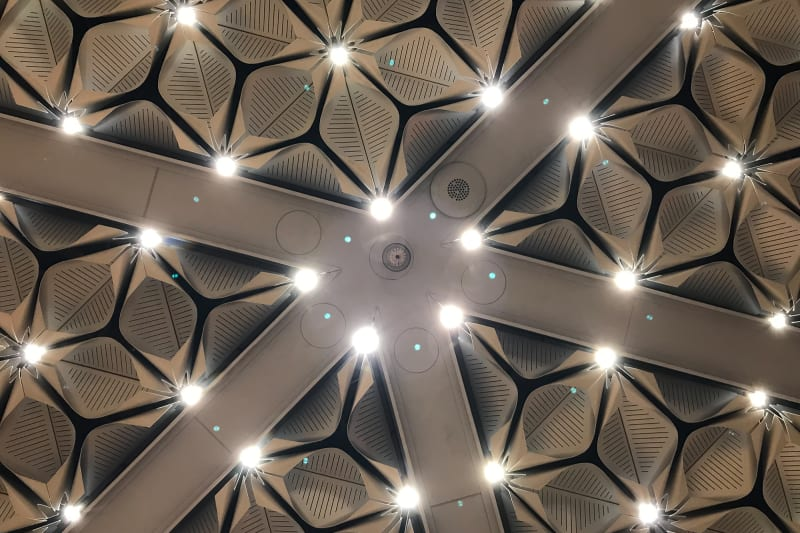 A detail shot of the celing lights in the Bloomberg building. There lights are small LEDs surrounded by curved plastic.