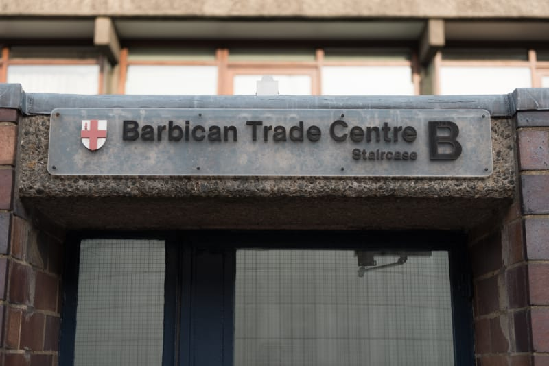 A photo of a sign that reads 'Barbican Trade Centre B'