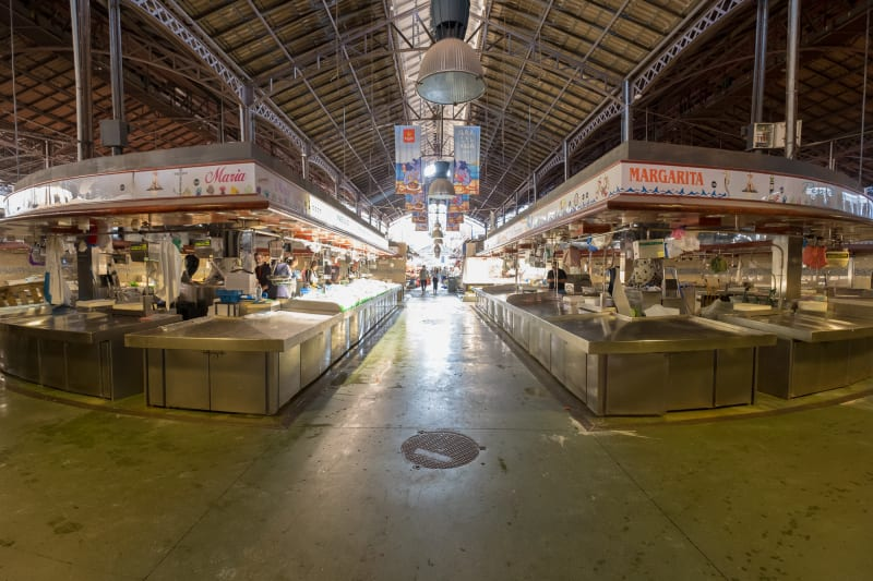Looking down the centre of a covered food market.