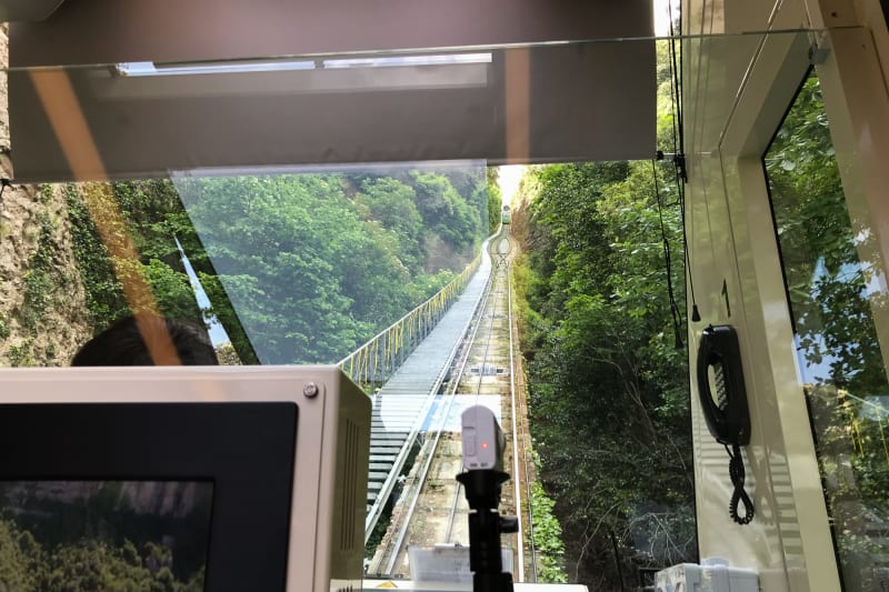 Looking up the tracks of a funicular railway from inside the train car.