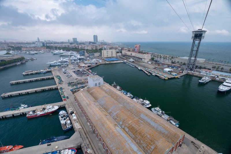 A photo taken from a cable car overlooking a port.