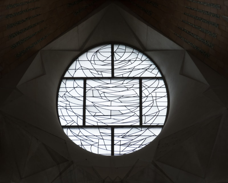 A patterned glass window in la Sagrada Família. It looks similar to an abstract stained glass window, but with frosty white glass.