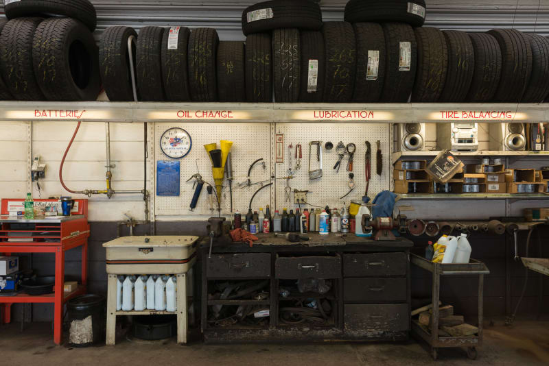 A photo directly facing a workbench inside an automotive garage.