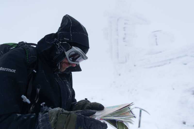 Ed Horsford reading a OS map next to the Cairngorm mountain weather station