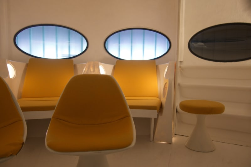 A detail of yellow padded seating inside Futuro house.