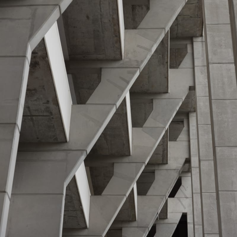 Looking up at a series of concrete supports.