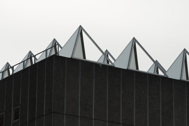 A close shot of the roof of the Hayward gallery. The roof is covered in metal and glass pyramids to capture light.