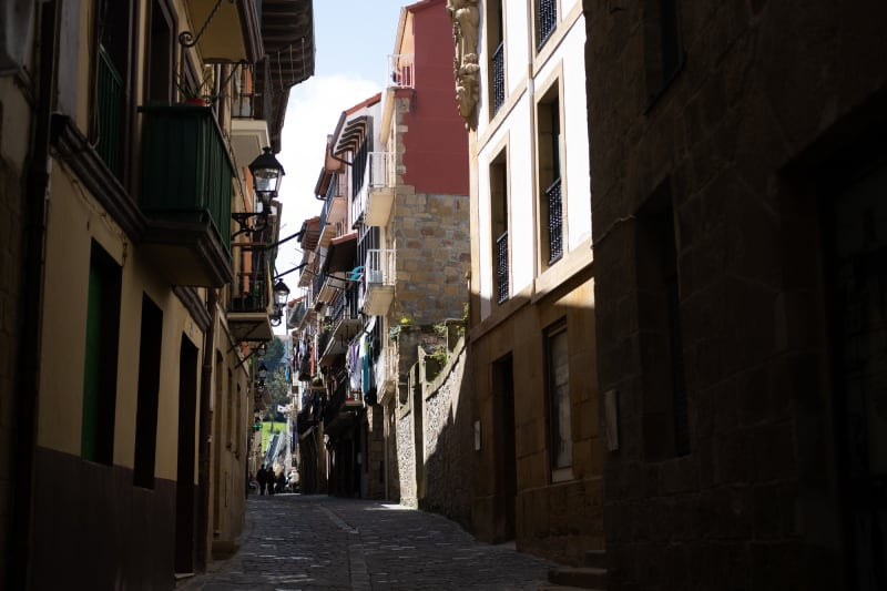 A narrow street in Getaria, with sunlight on one side.