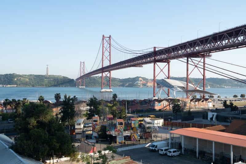 Looking out from high up at the 25 de Abril Bridge and Village Underground.