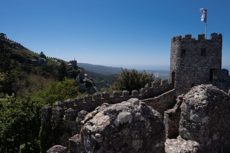 A view of one corner of the Castle of the Moors with fortified walls receding in to the distance.