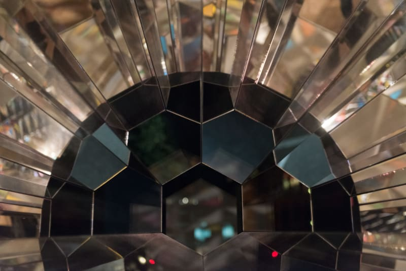 A black sphere made from many hexagons and pieces of mirror.