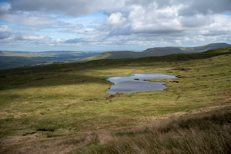 A small tarn in an otherwise featureless landscape.