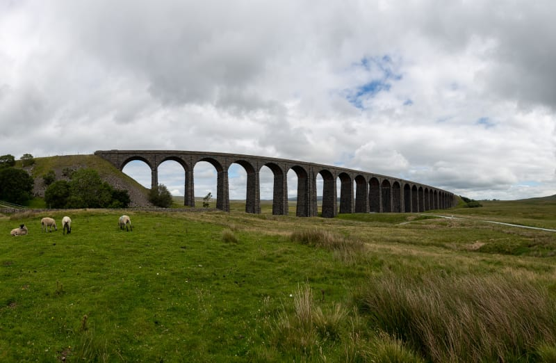 A panorama of Ribblehead Viaduct from a distance.