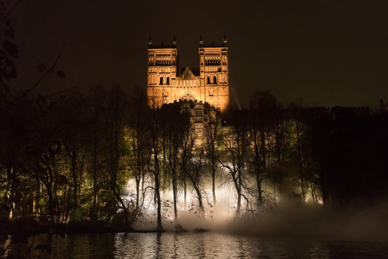 Durham Cathedral at night, shot from the opposite bank of the river. The trees below are full of white mist.