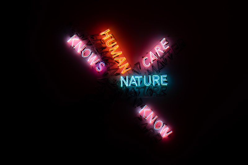 A large neon sculpture comprised of multiple overlaid words. Only some words are lit up.