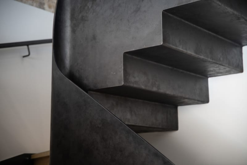 A detail shot of a metal staircase.