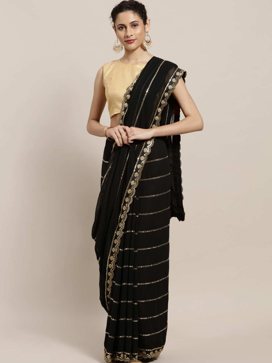 Sugathari Black & Golden Embroidered Poly Georgette Saree Price in India