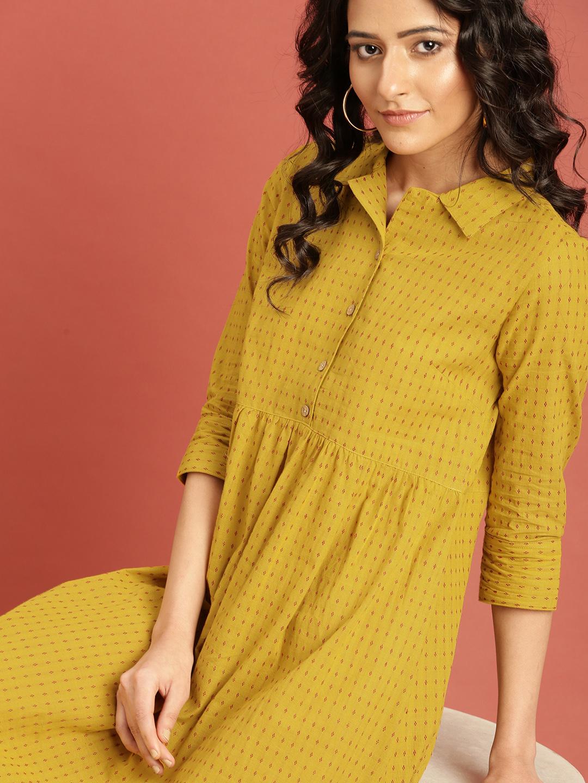 Taavi Women Mustard Self Design Empire Dress Price in India