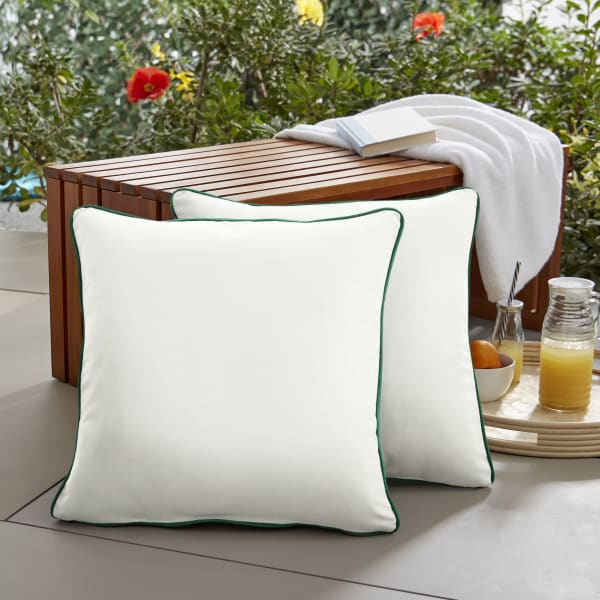 Sunbrella Corded Set of 2 in Canvas Natural with Canvas Forest Green Outdoor Pillows