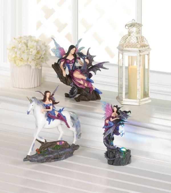 Purple and Blue Fairy Riding Unicorn Figurine