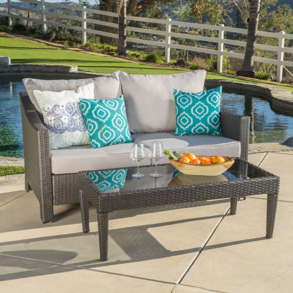 Gray Wicker Loveseat & Table with Silver Cushions