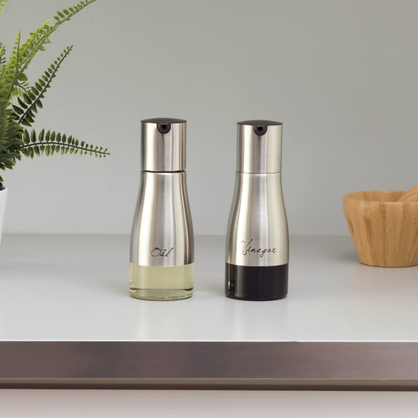 8.5 oz. Silver Oil and Vinegar Set with See-Through Glass Base
