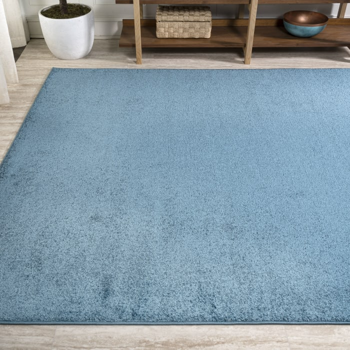 Haze Solid Low-Pile Turquoise Area Rug