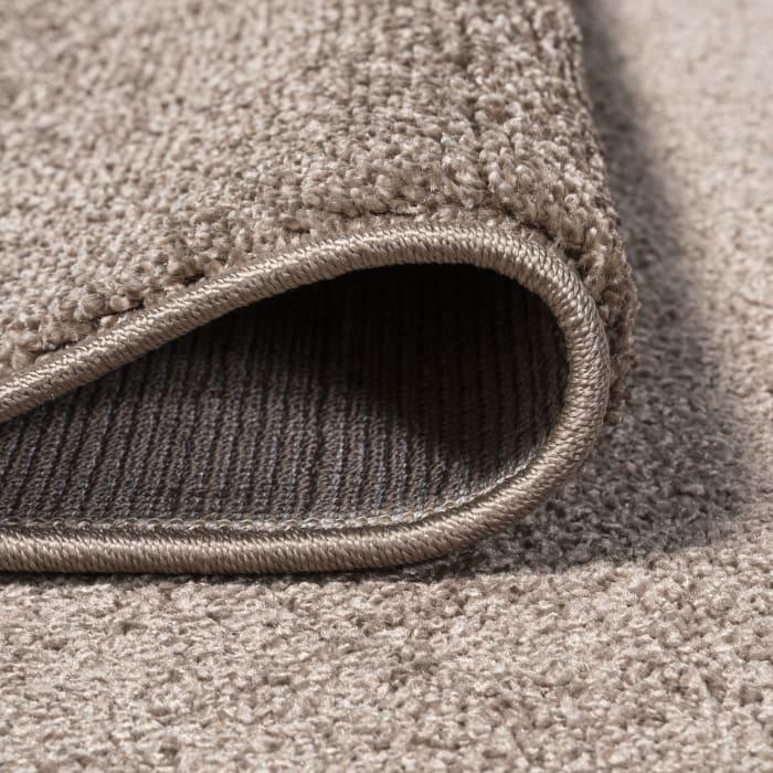 Haze Solid Low-Pile Brown Area Rug
