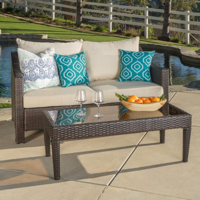 Multibrown Wicker Loveseat & Table with Beige Cushions
