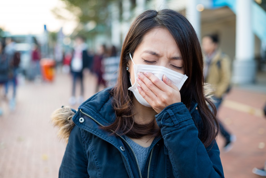 Woman feeling unwell at outdoor